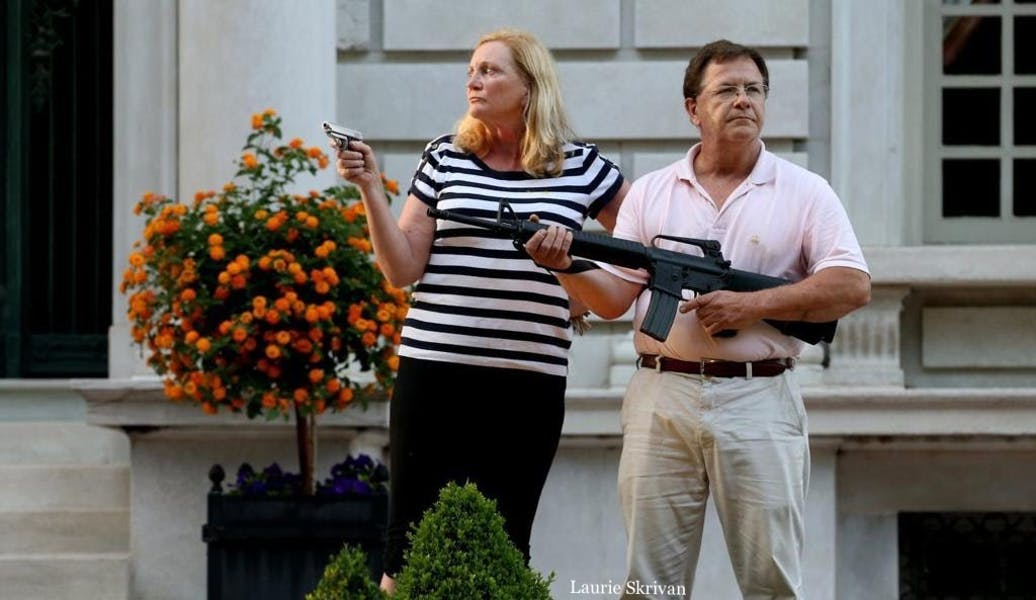 Was the St. Louis couple justified in brandishing firearms at protesters in front of their house?