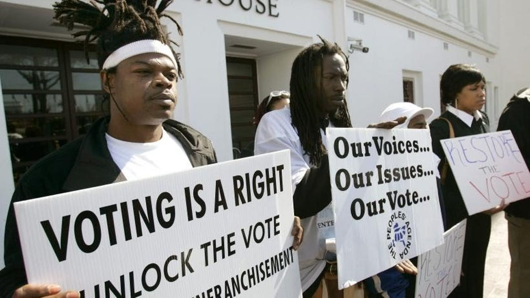 Should convicted felons lose their voting privileges while in prison?