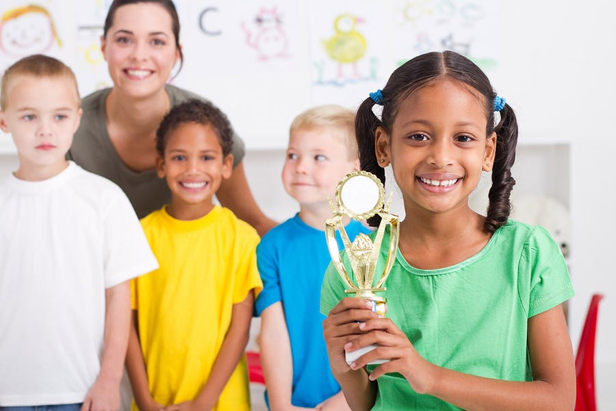 Should we reward children's competitions based on participation or results?